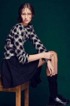 - Black asymmetric skirts